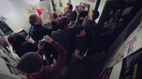 """A tour group sees the bathroom where many musicians have peed in KEXP's """"Tour Guide"""" bumper"""